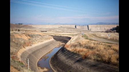 A trace of water sits in the bottom of the Madera Canal, which is fed by the nearby Friant Dam on the San Joaquin River in Friant, Calif.
